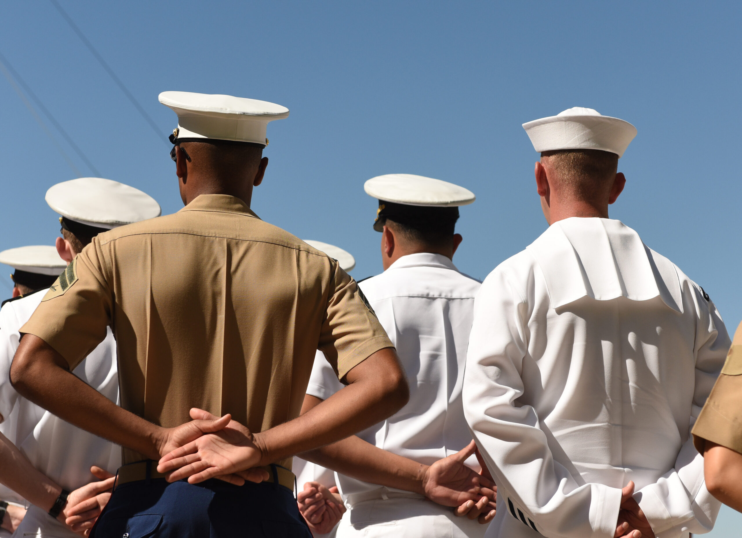US Navy sailors from the back